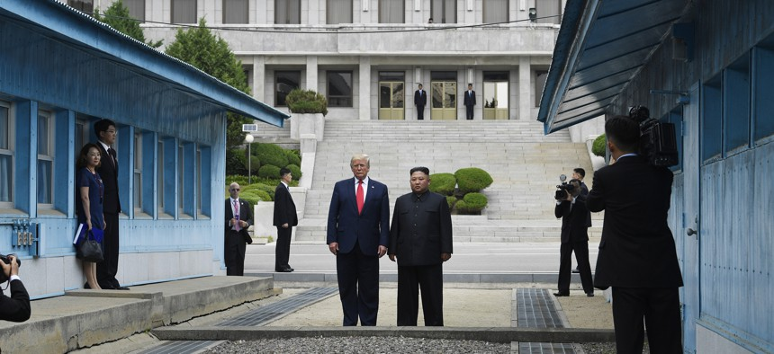 President Donald Trump meets with North Korean leader Kim Jong Un at the border village of Panmunjom in the Demilitarized Zone, South Korea, Sunday, June 30, 2019.