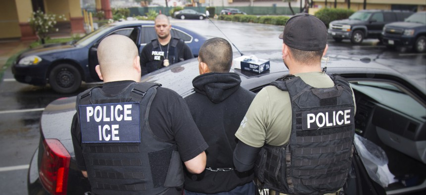 In this Feb. 7, 2017, photo released by U.S. Immigration and Customs Enforcement, foreign nationals are arrested during a targeted enforcement operation in Los Angeles.