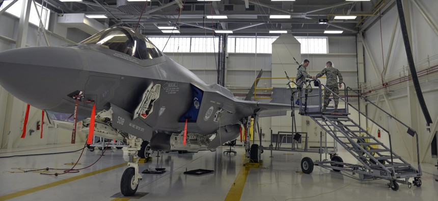 Airmen 1st Class Griffin Smith and William Manion, both 33rd Maintenance Squadron aircraft fuels system repairman apprentices, don safety gear to prepare an F-35A Lightning II for maintenance at Eglin Air Force Base, Fla., Jan. 13, 2016.