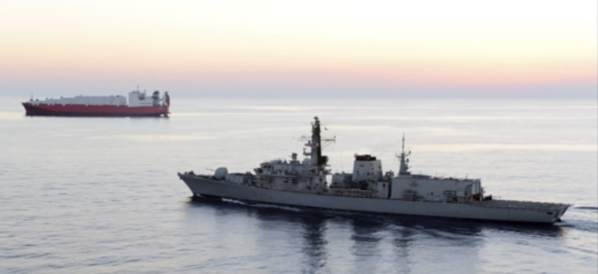 In this image from file video provided by UK Ministry of Defence, British navy vessel HMS Montrose escorts another ship during a mission to remove chemical weapons from Syria at sea off coast of Cyprus in February 2014.