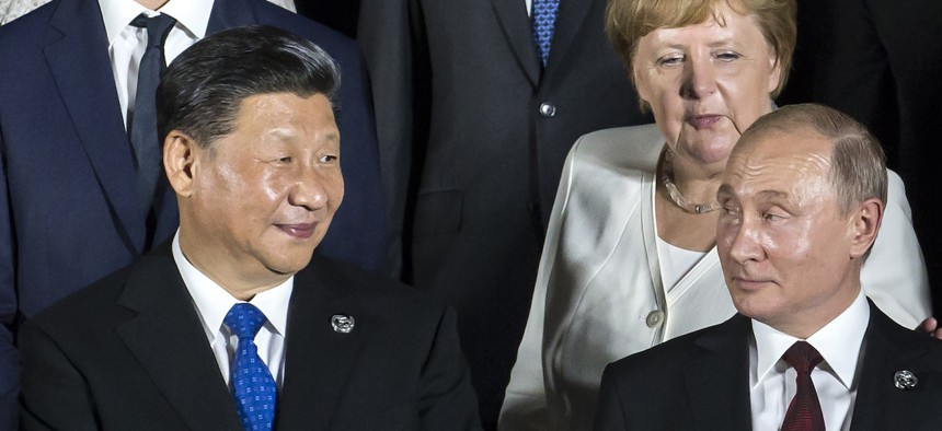 China's President Xi Jinping, left, and Russia's President Vladimir Putin, at the G-20 summit on Friday, June 28, 2019, in Osaka, Japan.