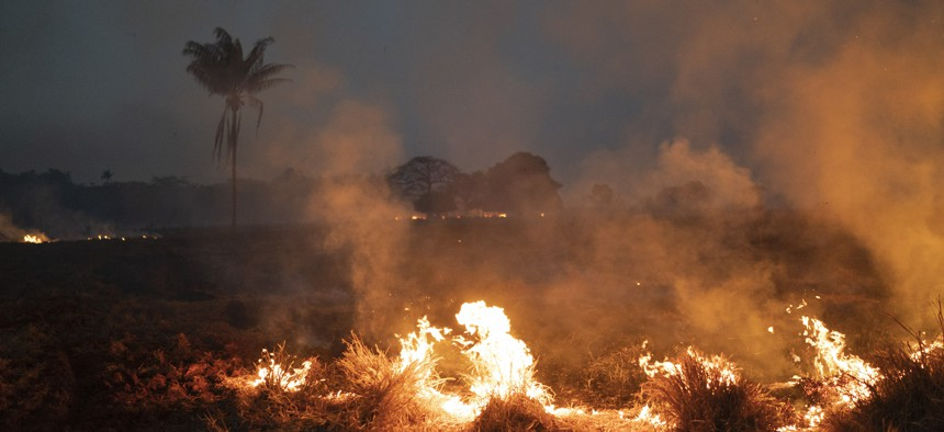 A fire burns a field on a farm in the Nova Santa Helena municipality, in the state of Mato Grosso, Brazil, Friday, Aug. 23, 2019.