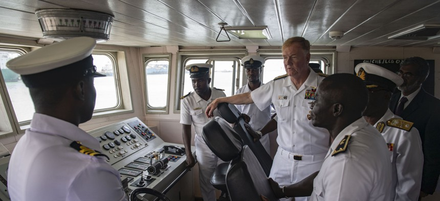 Adm. James G. Foggo III, center right, commander of U.S. Naval Forces Europe and Africa, tours the bridge of the Ghanaian navy ship GNS Chemle (P 36) during a site visit to Sekondi, Ghana, July 23, 2019.