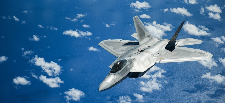 A United States Air Force F-22 Raptor from Joint Base Pearl Harbor-Hickam in Honolulu, Hawaii, flies over the Pacific Ocean during the Sentry Aloha exercise at Joint Base Pearl Harbor-Hickam, August 27, 2019. Aircraft from around the world took part.