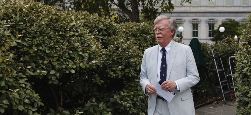 National security adviser John Bolton walks to speak to media at the White House in Washington, Wednesday, July 31, 2019.