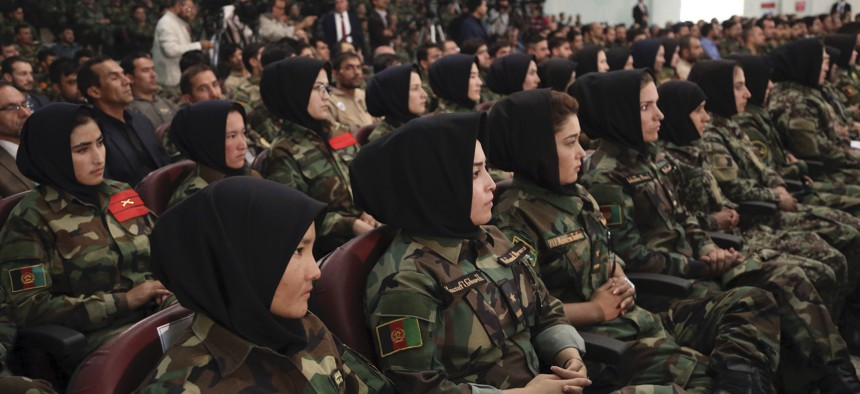 Afghan army soldiers listen to a speech by President Ashraf Ghani during a ceremony to introduce the new chief of the intelligence service, in Kabul, Afghanistan, Monday, Sept. 9, 2019.