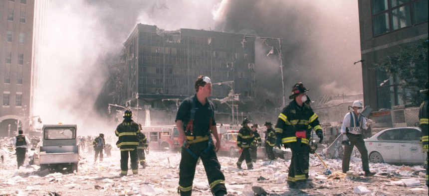 New York City firefighters work near the area known as Ground Zero after the collapse of the Twin Towers September 11, 2001 in New York City.
