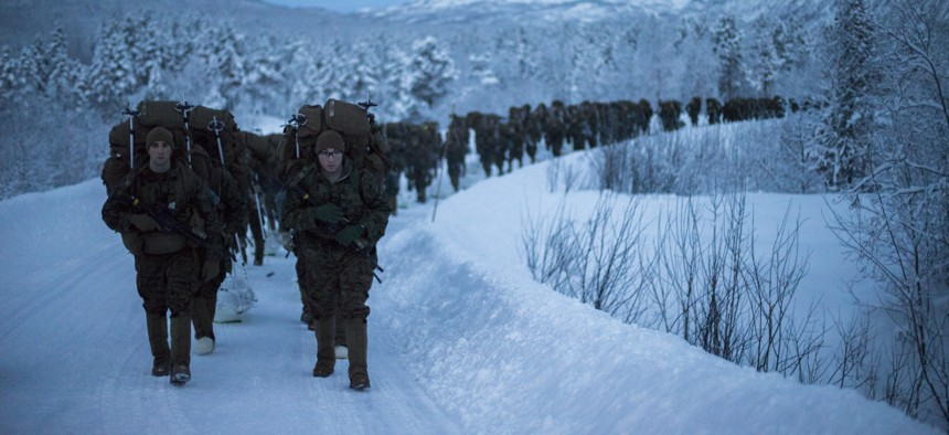 Marines with U.S. Marine Rotational Force-Europe train for arctic combat and survival on a 19.1 hike with a combat load during exercise White Ulfberht, in Setermoen, Norway, Jan. 14, 2019.