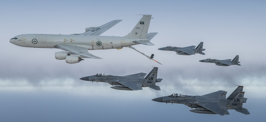 A Royal Saudi Air Force K-3 Tanker and Royal Saudi Air Force F-15C Eagles fly in formation with U.S. Air Force F-15Cs in the U.S. Central Command area of responsibility, June 2, 2019.