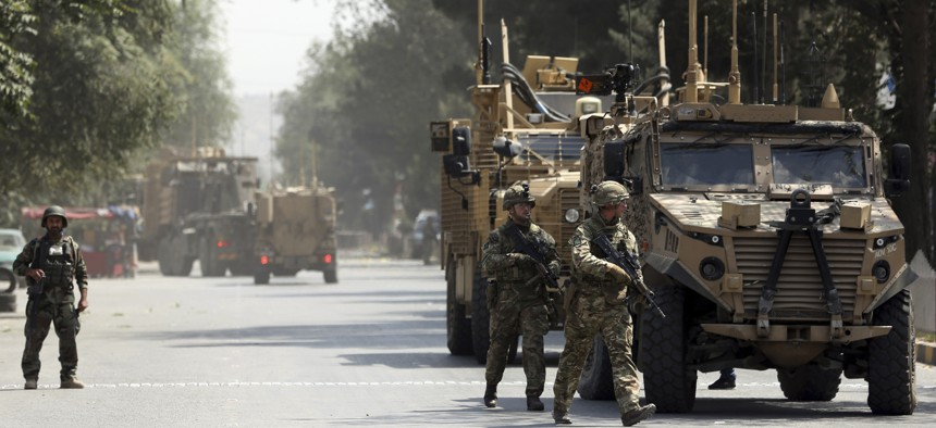 Resolute Support forces arrive at the site of a car bomb explosion in Kabul, Afghanistan, near the U.S. Embassy and other diplomatic missions, Thursday, Sept. 5, 2019.