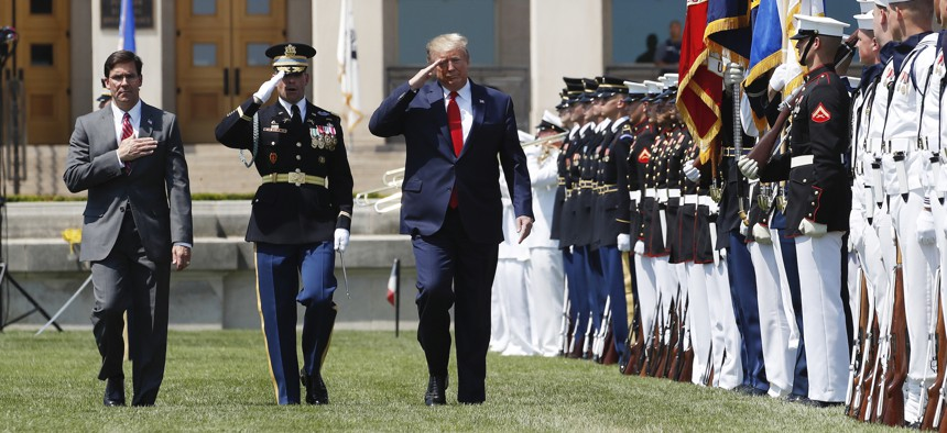 President Donald Trump, right, and Secretary of Defense Mark Esper, left, salute the flags, during a full honors welcoming ceremony for Esper at the Pentagon, Thursday, July 25, 2019, in Washington.
