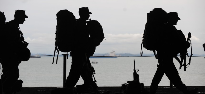 Marines serving with the 11th Marine Expeditionary Unit prepare to depart USS Makin Island to begin a training exercise in 2011.