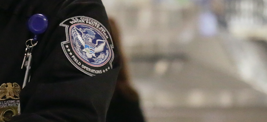 2016 photo of a Customs and Border Protection officer at Dulles International Airport.