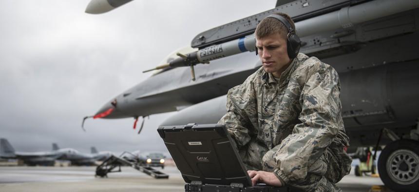 Staff Sgt. Zackery Coder checks computer data during Red Flag-Alaska 14-2, June 19, 2014, on Eielson Air Force Base, Alaska.