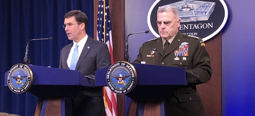 Defense Secretary Esper and Gen. Mike Milley address the press at the Pentagon briefing room on Fri., Oct. 11, 2019.
