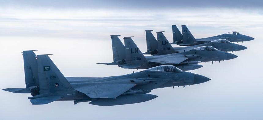 Royal Saudi Air Force F-15C Eagles fly in formation with U.S. Air Force F-15Cs in the Middle East.