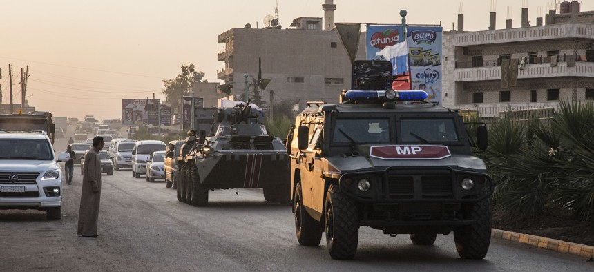 Russian forces patrol in the city of Amuda, north Syria on Oct. 24, 2019, part of a zone 30 kilometers (19 miles) deep along much of the northeastern border, under an agreement reached Tuesday by Russia and Turkey.