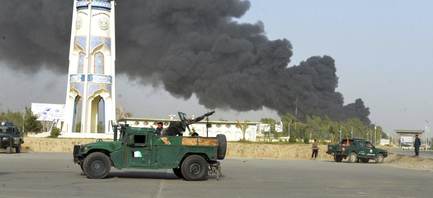 Afghan security forces arrive after a powerful explosion outside the provincial police headquarters in Kandahar province south of Kabul, Afghanistan, Thursday, July 18, 2019.