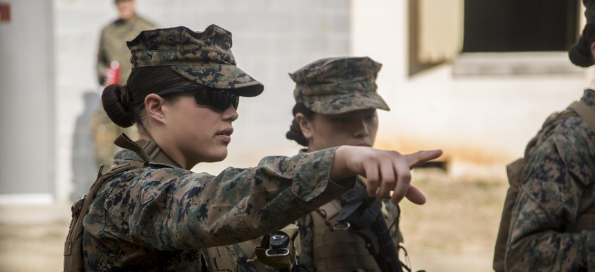 U.S. Marines assigned to the Female Engagement Team (FET), 22nd Marine Expeditionary Unit, discuss a plan of action before conducting an urban operations training exercise at Fort Pickett, Va., Feb. 21, 2016.