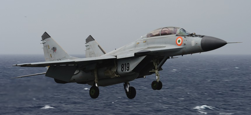 "An Indian navy MIG-29K ""Fulcrum"" flies over the aircraft carrier USS Nimitz (CVN 68) during Exercise Malabar 2017."