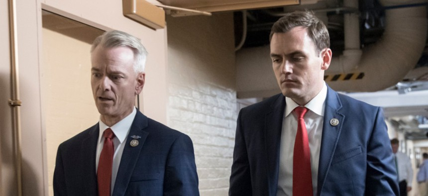 Rep. Mike Gallagher, R-Wis., walks through the Capitol with Rep. Steve Russell, R-Okla.