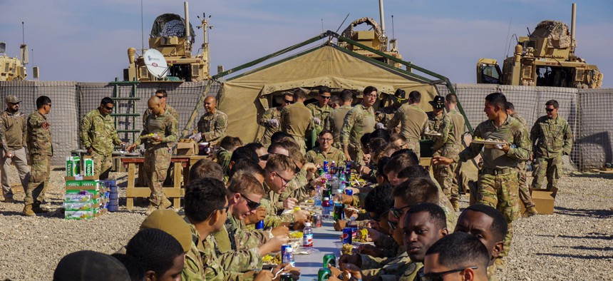 Soldiers assigned to 3rd Cavalry Regiment enjoy Thanksgiving dinner on Fire Base Saham, Iraq, Nov. 20, 2018.