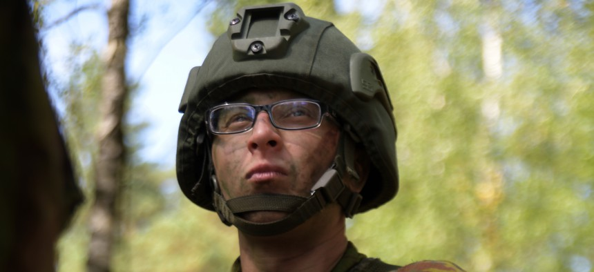 A Lithuanian soldier prepares his kit for the automatic rifle iteration during the live-fire event of the Lithuanian Land Forces Best Infantry Squad Competition Aug. 28, 2019, in Rukla, Lithuania