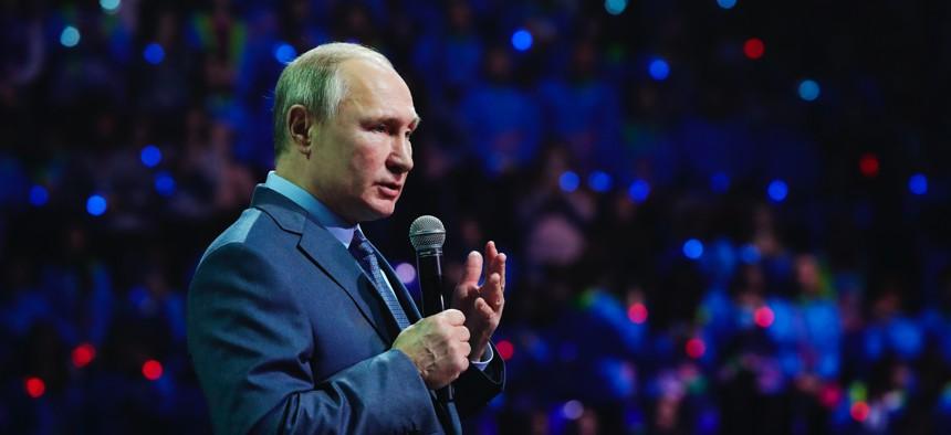 Russian President Vladimir Putin speaks during the International Volunteer Forum at the Olympic Park in Sochi, Russia, Dec. 5, 2019.