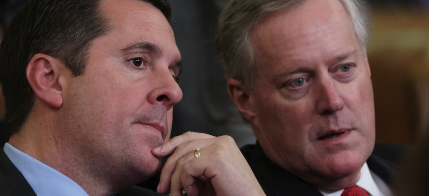 Rep. Devin Nunes, R-Calif, left, the ranking member of the House Intelligence Committee, speaks with Rep. Mark Meadows, R-N.C., as the House Judiciary Committee holds a hearing on impeachment on Dec. 4, 2019.