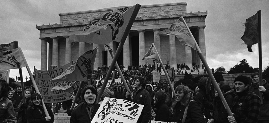 """Thousands of antiwar demonstrators mass in front of the Lincoln Memorial in Washington, D.C., Jan. 20, 1973 taking part in a """"March Against Death."""""""