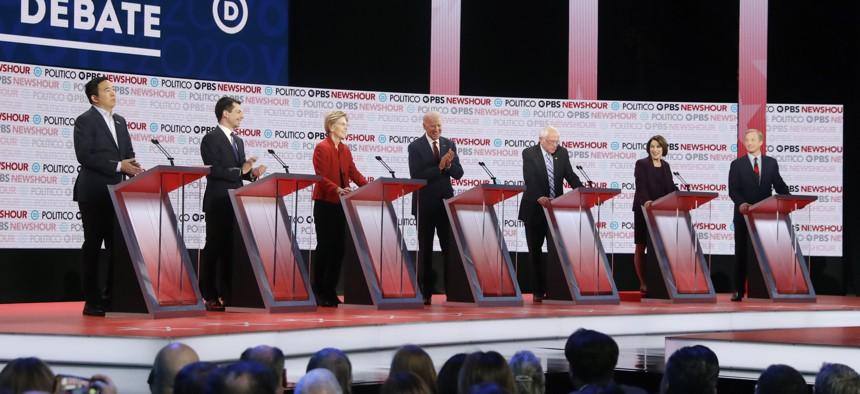 Democratic presidential candidates from left, entrepreneur Andrew Yang, South Bend Mayor Pete Buttigieg, Sen. Elizabeth Warren, D-Mass., former Vice President Joe Biden, Sen. Bernie Sanders, I-Vt., Sen. Amy Klobuchar, D-Minn., and businessman Tom Steyer.