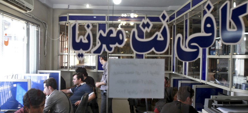 Iranians surf the Internet at a cafe in Tehran, Iran, Tuesday, Sept, 17, 2013. The joy of Iran's Facebook and Twitter fans was short-lived as authorities on Tuesday restored blocks on social networks after filters were lifted for several hours overnight.