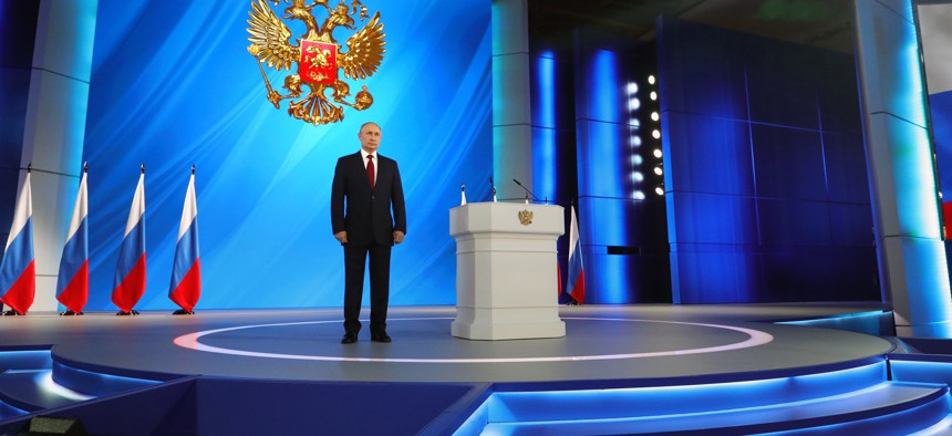 Russian President Vladimir Putin listens the national anthem after his speech to the State Council in Moscow, Russia, Wednesday, Jan. 15, 2020. Putin proposed changing the Russian Constitution to increase the powers of parliament and the Cabinet.
