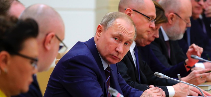 Russian President Vladimir Putin attends a meeting on drafting constitutional changes at the Novo-Ogaryovo residence outside Moscow, Russia, Thursday, Jan. 16, 2020.
