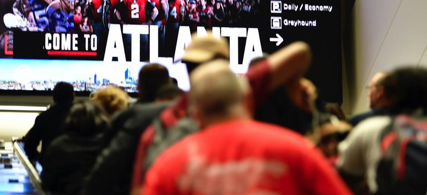 Travelers move in Hartsfield-Jackson Atlanta International Airport , Monday, Sept. 9, 2019, in Atlanta.