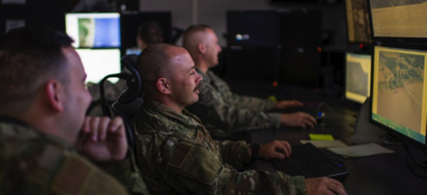 Intelligence analysts with the Indiana Air National Guard's 181st Intelligence Wing help the JAIC develop artificial intelligence programs for domestic operations at Hulman Field Indiana National Guard Base, Ind., on Nov. 02, 2019.