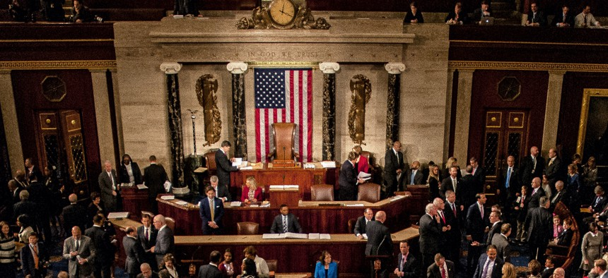 January 3, 2017: Members of the 115th congress and their familes mingle on the house floor while attending the joint session on the opening day of the session.