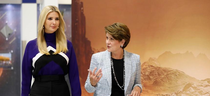 Lockheed Martin CEO Marillyn Hewson walks with Ivanka Trump at a Lockheed Martin space facility outside Denver, Colorado.