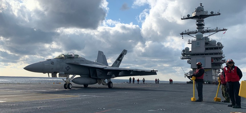Crews ready an F/A-18 Super Hornet for take off on the deck of USS Gerald R. Ford on Monday Jan. 27.