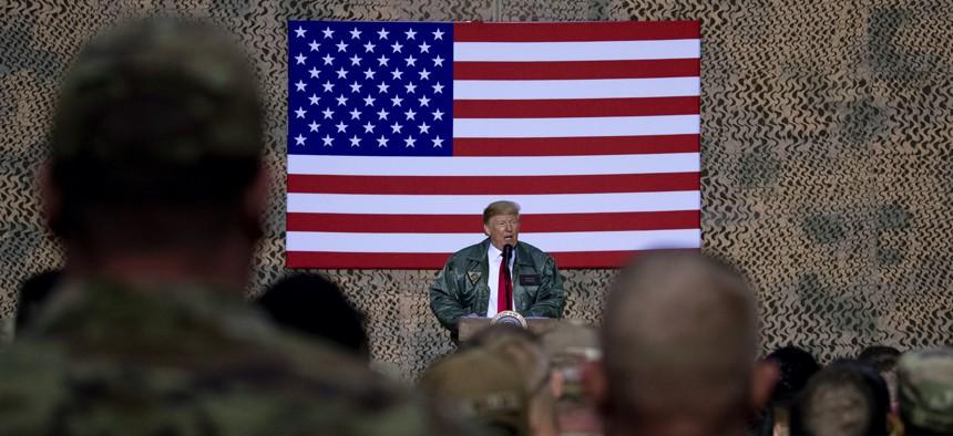 President Donald Trump speaks at a hangar rally at Al Asad Air Base, Iraq, Wednesday, Dec. 26, 2018.
