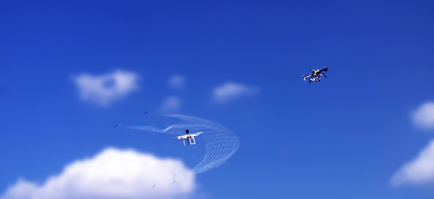 The Fortem Technologies DroneHunter deploying a net to capture a drone.