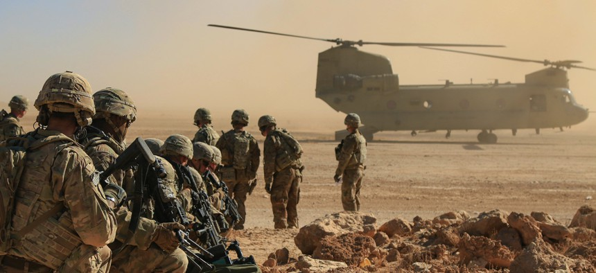 Soldiers assigned to the 1st Squadron, 3rd Cavalry Regiment, await extraction via a CH-47 Chinook during an aerial response force live-fire training exercise, Al Asad Air Base, Iraq, Oct. 31, 2018.