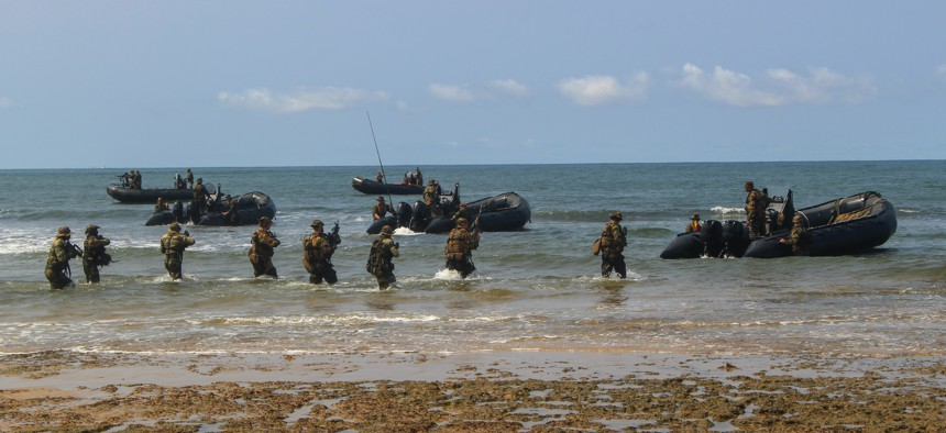 U.S. Marines and Belgian Army soldiers withdraw from the beach during an amphibious landing demonstration during the closing ceremonies for Exercise Tropical Storm in Akanda, Gabon, Dec. 15, 2019.