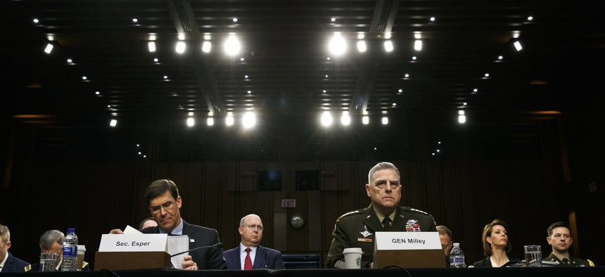 Defense Secretary Mark Esper, left, and Chairman of the Joint Chiefs of Staff Gen. Mark Milley, listen during a Senate Armed Services Committee on budget posture, Wednesday, March 4, 2020, on Capitol Hill in Washington.