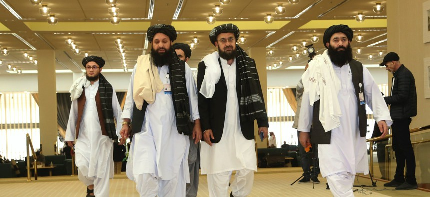 Afghanistan's Taliban delegation arrive for the agreement signing between Taliban and U.S. officials in Doha, Qatar, Saturday, Feb. 29, 2020.