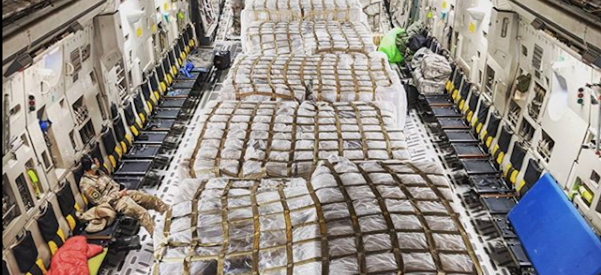 """This photo was posted with the caption: """"Got to be part of something special last night. These pallets right here are 500,000 covid-19 testing kits that the aircrew I was a part of…"""" The post has since been taken down."""