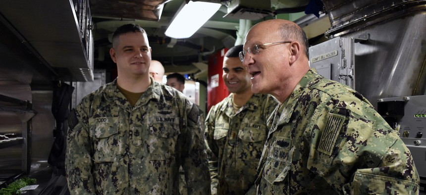 GROTON, Conn. (Feb. 24, 2020) Chief of Naval Operations (CNO) Adm. Mike Gilday speaks with Sailors while they wait in the chow line for lunch aboard the Virginia-class fast-attack submarine USS Colorado (SSN 788).