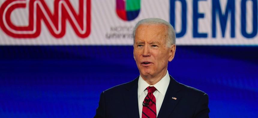 In this Sunday, March 15, 2020, photo, former Vice President Joe Biden, with Sen. Bernie Sanders, I-Vt., speaks during a Democratic presidential primary debate at CNN Studios in Washington.