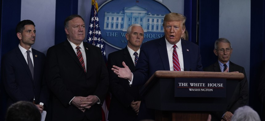 President Donald Trump responds to a question by NBC News White House correspondent Peter Alexander during a coronavirus task force briefing at the White House, Friday, March 20, 2020, in Washington.