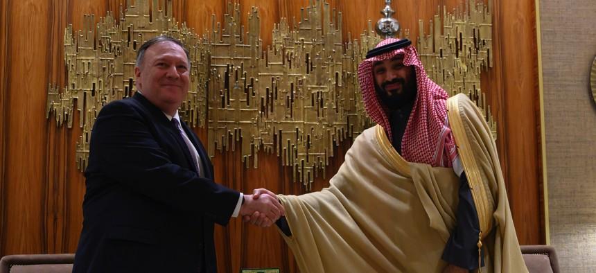 U.S. Secretary of State Mike Pompeo, left, shakes hands with Saudi Arabia's Crown Prince Mohammed bin Salman at Irqah Palace, in the capital Riyadh Saudi Arabia, Thursday, February 20, 2020.